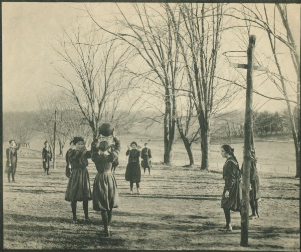 Girls play basketball outdoors at the Hillside School Wisconsin Historical Images