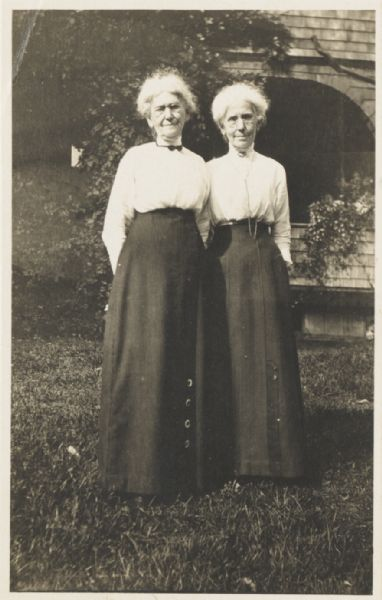 Ellen Lloyd Jones and her sister Jane Lloyd Jones standing in front of the Hillside School which they founded and managed.