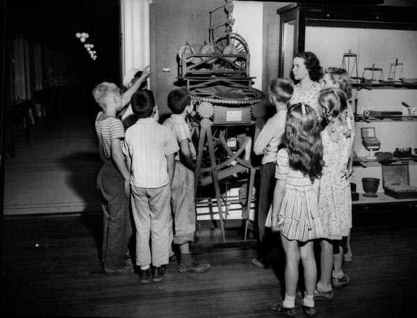 Kids gather around John Muir's study desk Wisconsin Historical Images